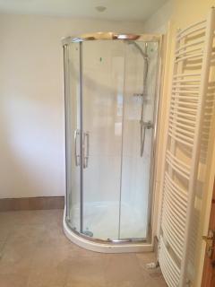 Shower and heated towel rail in ensuite bathroom