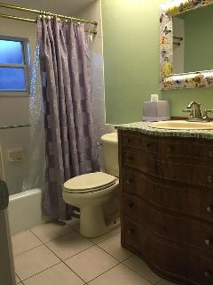 Full bathroom with tub and linen closet