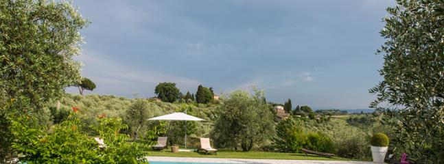 swimming pool with view over Tuscan hills
