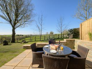 Beautiful Large private patio and BBQ area looking out across open fields and woodland -