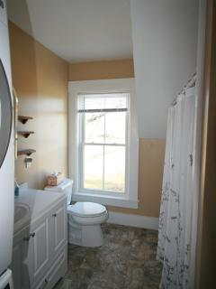 Bathroom with Full Tub/Shower Large Capacity LG Washer/Dryer