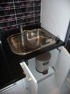 Shower of sink can be taken out. Cupboard under sink with bin