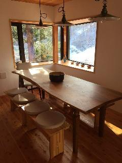 Long wooden table that can sit 10 persons. No matter where you sit, you will have  a view.