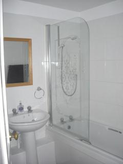 Bathroom with over bath Mira shower