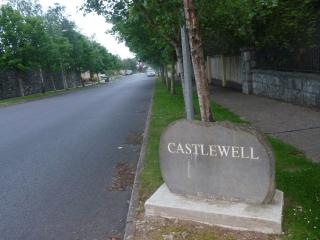 Tree lined avenue into Castlewell Estate