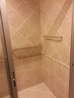 Entrance door of shower room with view on 2 hang ups for towels, level adapted for wheelchair users