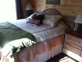 Master bedroom with King bed on main floor - no stairs to get here.