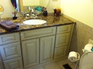 Master bath has large cabinet for all your needs and a shower.