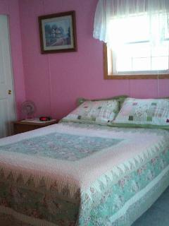 The second bedroom has a double bed and spacious closets. There is a desk also.