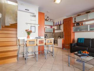 Cozy but well equipped family friendly duplex with two verandas