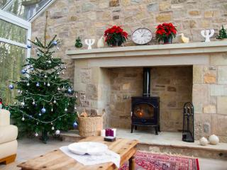 A real and decorated Christmas Tree and logs for the woodburning stove make a lovely Christmas stay