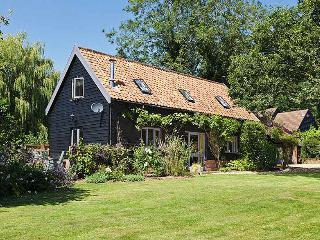 Willow Farm Cottage. A newly refurbished barn in extensive and private gardens.