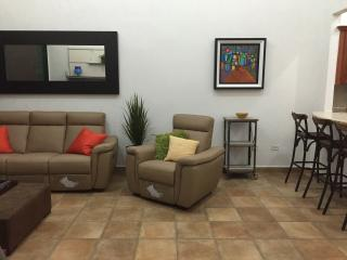 living room with charging station for phones and pads