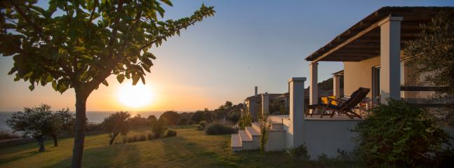 golden sunset at Ploes Villas