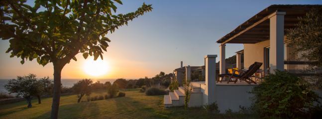 golden sunset at Ploes Villas