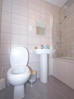 The newly fitted bathroom is luxuriously finished with a shower and bath