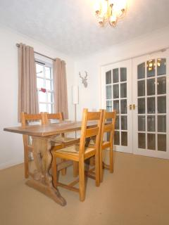 The kitchen is in easy access of the dining area