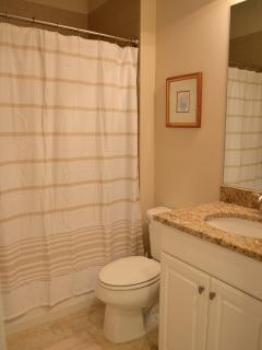 Guest bathroom/powder room adjacent to King guest room, tub and shower