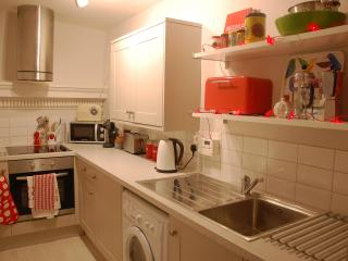 The newly installed, fully equipped kitchen, including coffee machine, washer dryer, microwave...