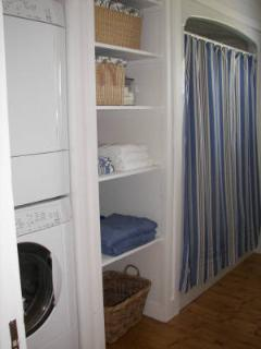 Bathroom with built-in washer and dryer.