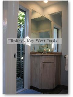 The En-Suite Bath features an Open-Air Shower...