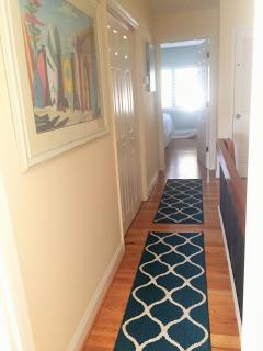 Hallway joining bedrooms + another storage closet with beach towels & more...