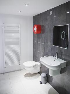 Brand new wet room with bath and rainfall shower! Perfect for starting the day.