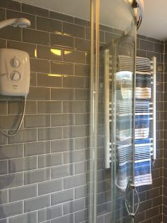 Corner shower cubicle and heated towel rail