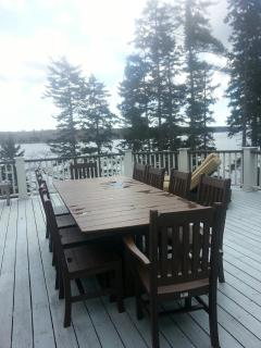 Dining on the deck w/seating for 10, large umbrella, incredible water views, near BBQ grill.
