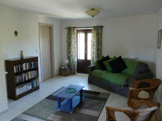 Spacious comfortable living room with doors to balcony