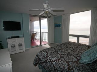 Wake up each morning to a beautiful beach view fro the mater bedroom. (Patio is not red, tile is bei