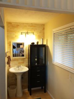 The master bath has separate wash area, shower and private toilet.