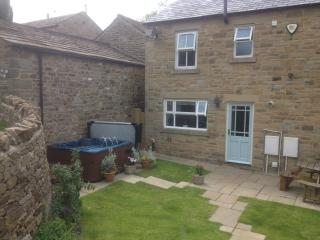 Rear enclosed garden showing private hot tub