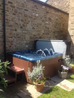 Own private hot tub in the rear garden