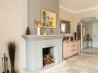 The attractive feature fireplace gives real character to the room.