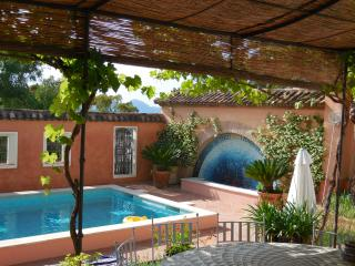 Magical village property with large pool & garden.