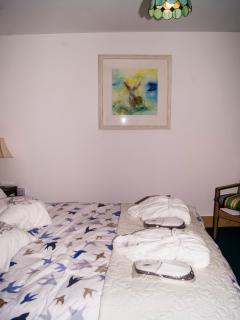 Bedroom 2 featuring 'The Emperor' painting by Melody