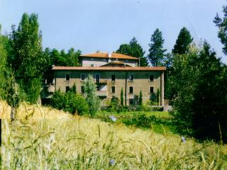 The Villa in Summer from the fields below