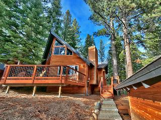 This gorgeous house is nestled in the woods and offers plenty of peace and quiet.