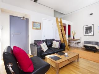 A beautiful one-bedroom loft with amazing views of St Paul's and The Shard., London