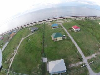 Picture from drone showing the area. D Beach House is the Yellow house with the Green metal roof.