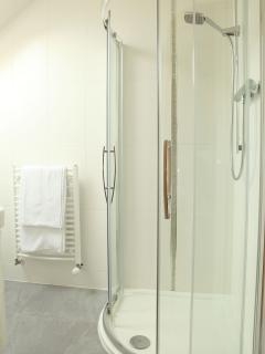 En suite shower with each bedroom