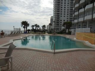 Heated outdoor pool with beach access
