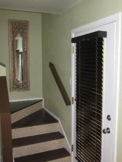 Staircase to upstairs bedroom & office