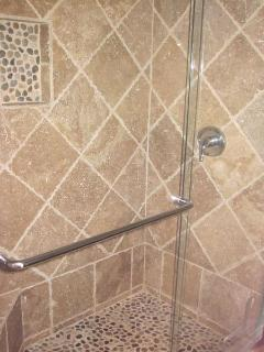 Floor to ceiling shower.