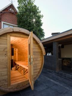 Garden with sauna, jacuzzi, hot tub, lounge, covered outdoor kitchen and bbq.