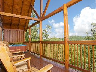 Chairs and hot tub on the cabin's deck.