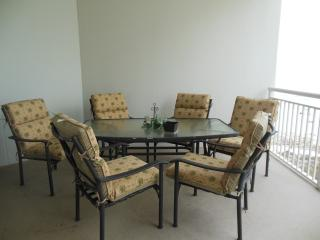 Large patio with seating for six plus 2 lounge chairs