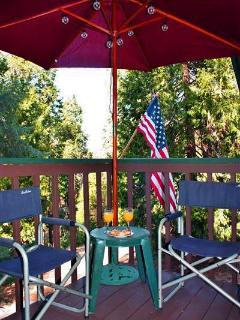 Relax outside on the deck with a tasty beverage and enjoy the scenery