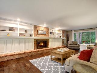 Warm up by the beautiful brick hearth in the home's den.
